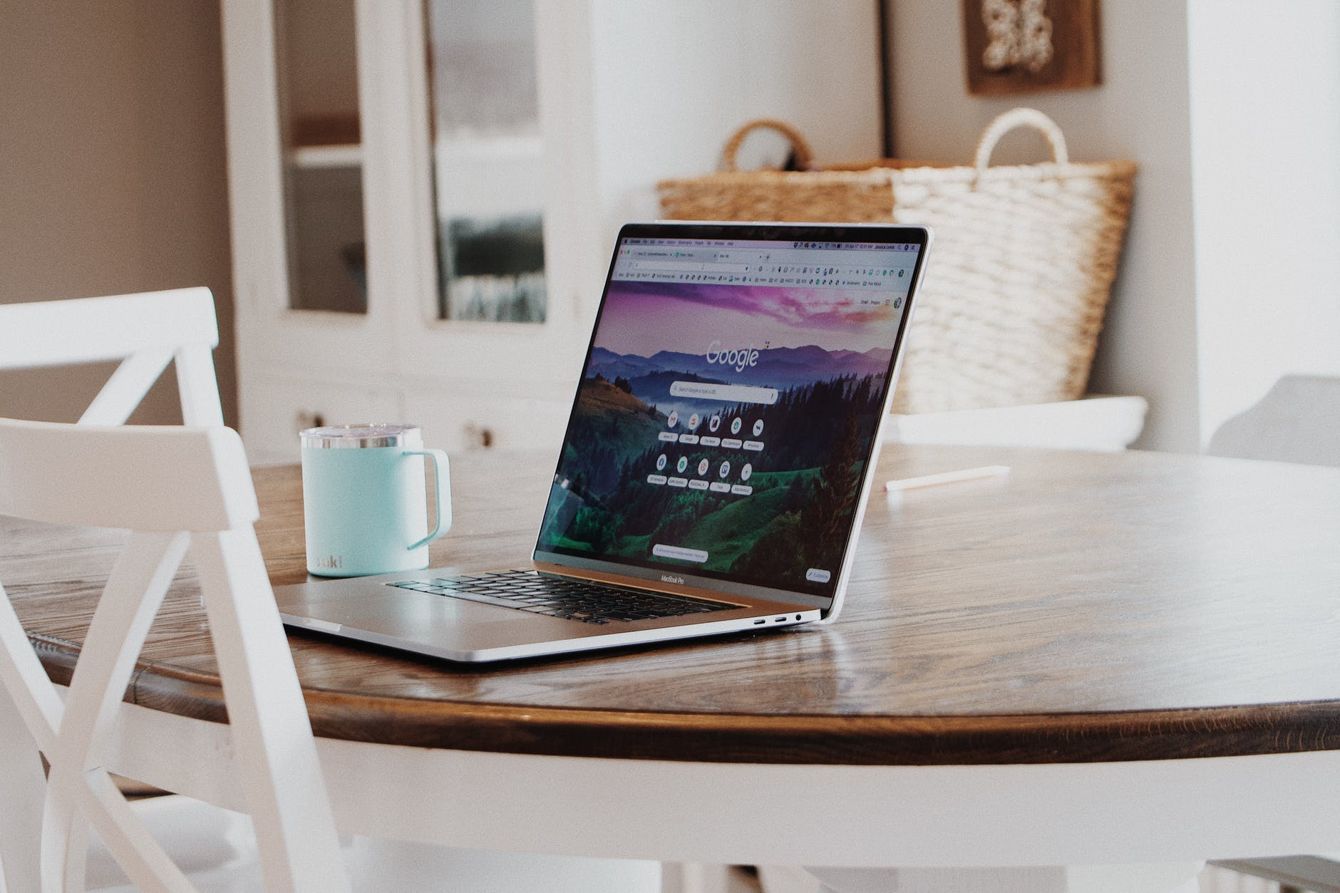 Open laptop on a coffee table