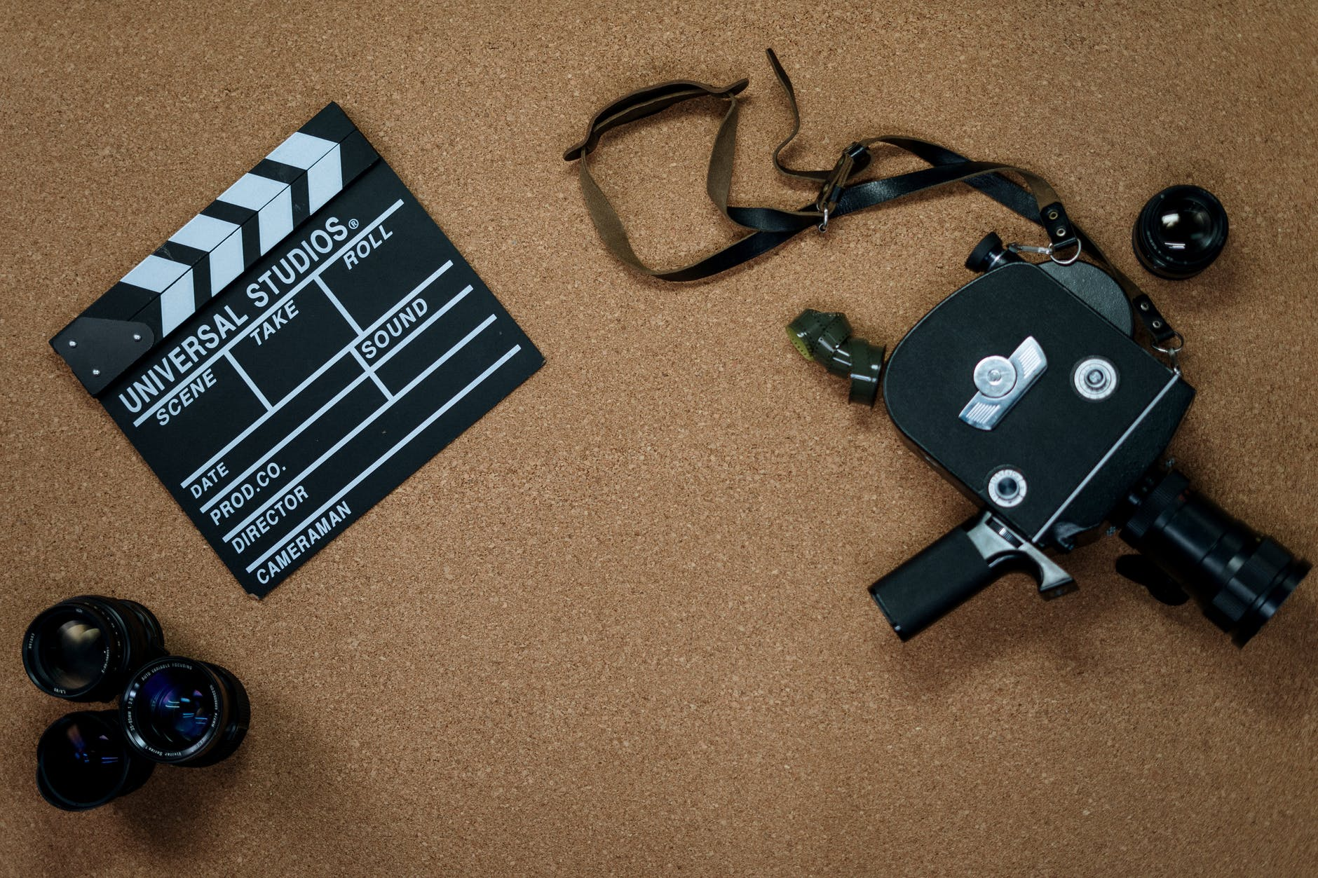 A video camera with lenses lying around and take scene board