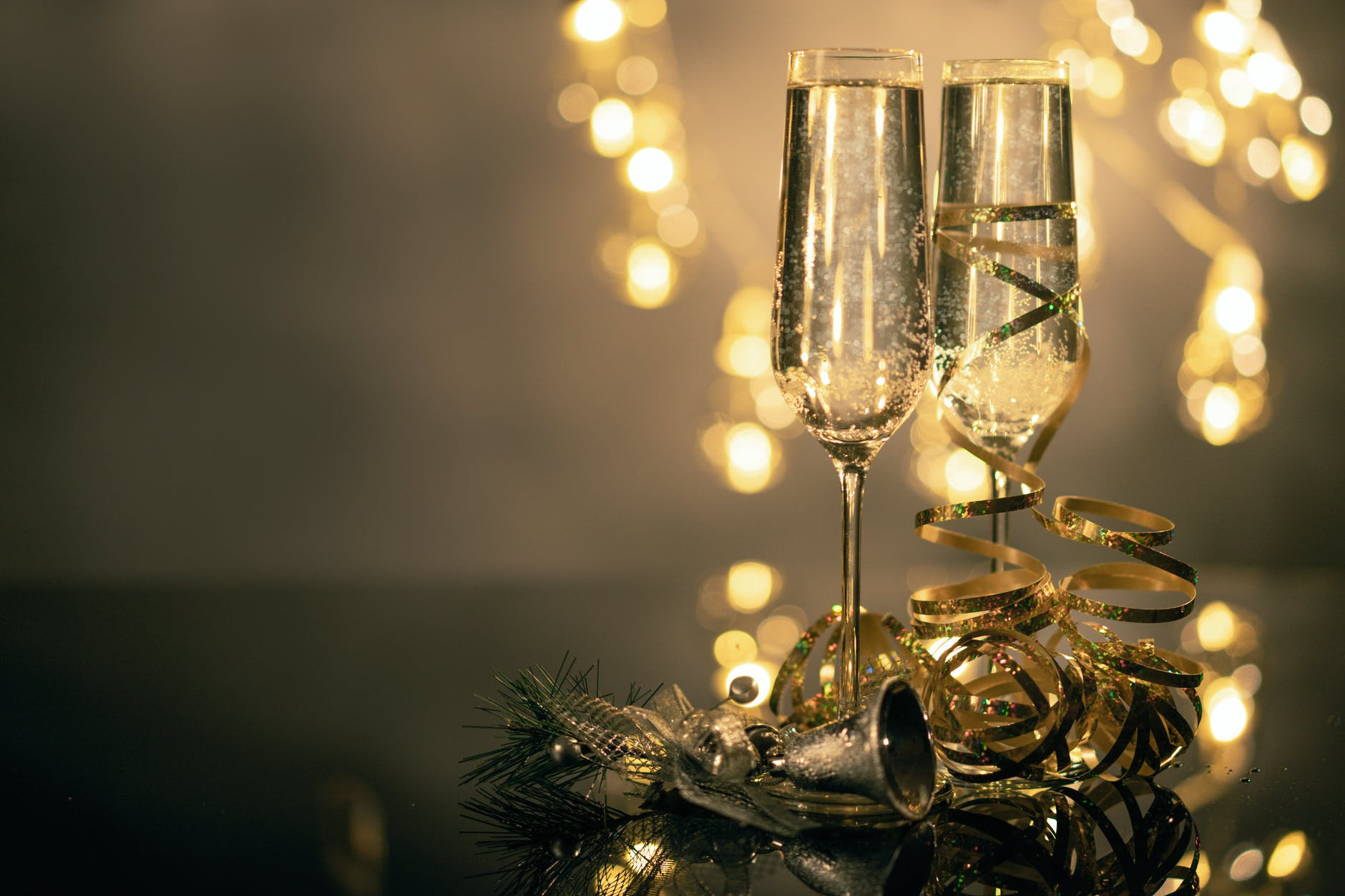 2 champagne glasses with Christmas decoration at the stem