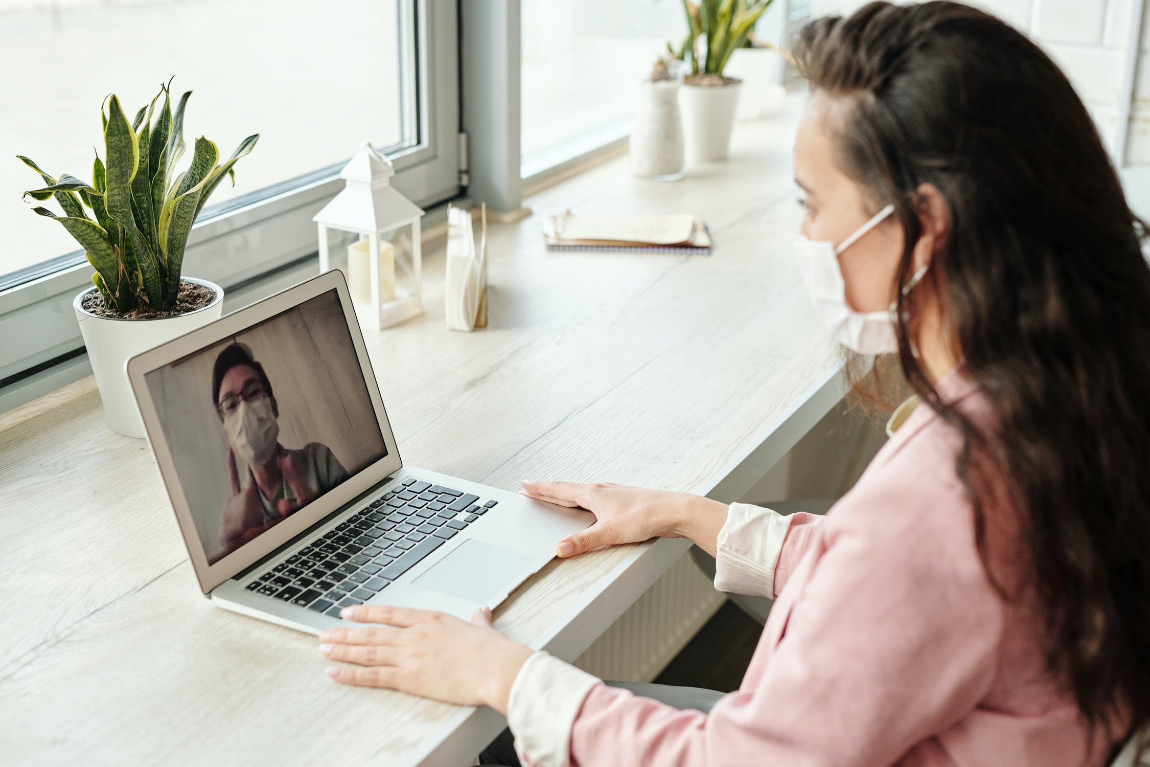 A female with mask video calling a male with a mask on