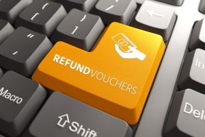 Keyboard with a yellow button saying Refund Vouchers