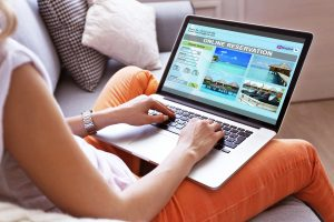 Woman using laptop to book hotel online